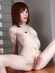 Redhead Japanese TS Yui Kawai has a petite body with a delicious firm booty! Watch her posing and stroking her small cock in this hot solo scene!